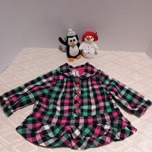 Place bright plaid ruffled flannel